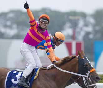 Jose Valdivia Jr. celebrates after Belmont