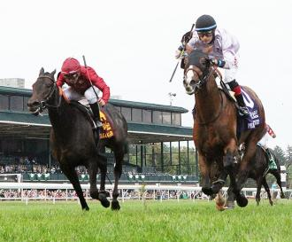 Vitalogy (left) finishes second in the Bourbon Stakes at Keeneland Race Course